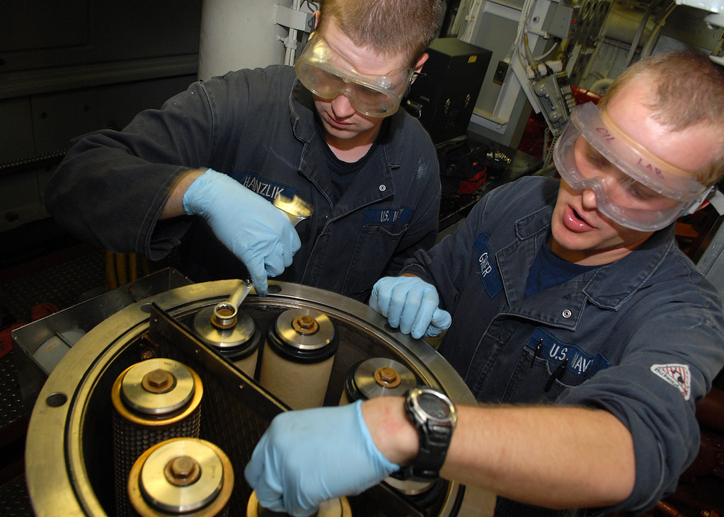 Sailors calibrate a fuel filter aboard USS Shoup.
