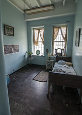 Quarters (trainmann1) Tags: nikon d90 tokina 1116mm amateur handheld transalleghenylunaticasylum lunaticasylum weston wv westvirginia westonstatehospital statehospital hospital building inside interior summer june 2017 antique vintage abandoned neglected rusty rust crusty crust peel nasty old aged room cell bed cot windows walls blue white brown lonely desolate