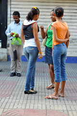 Chit Chatting (vinylmeister) Tags: camera girls people woman fashion photography chica dominicanrepublic events year streetphotography places jeans dominicana chicas denim behind brands santodomingo 2010 photocamera streetfashion photograpy dominicanrepublicrepublicadominicana otherkeywords nikond700 nikonafnikkor85mmf14dif holidays2010