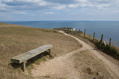 Bench on Beer Common (Alastair Cummins) Tags: ocean sea water fence bench coast path cliffs 1855mm jurassic nion d40
