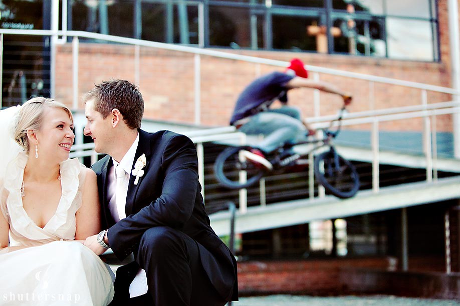 Bride, groom and BMX bike rider