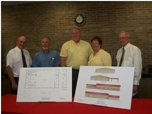 O'Neill, Nebraska Community Center plans are discussed and displayed.   Pictured with plans of the center are (L-R):  Rich McIntosh, Don Baker, Mayor Bill Price, State RD Director Maxine Moul and Jim Rabe.