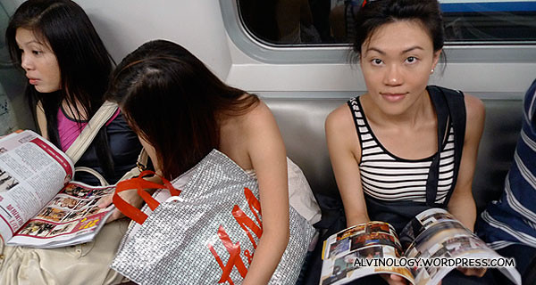 Rachel blending in with Hong Kongers with her magazine in the train