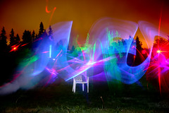 light painting! (Raymond Zoellick) Tags: camera trees light red sky orange white color green fog night digital yard canon painting fun rebel star chair glow machine running saber laser lightsaber blueray