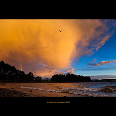 rainbow (stella-mia) Tags: sunset sky orange cloud sun lake storm rain yellow norway clouds landscape rainbow explore orangesky hamar mjsa 2470mm hightlight yellowsky explored canon5dmkii lakemjsa