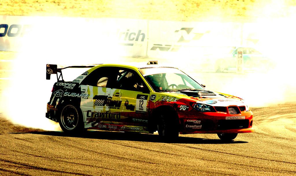 Cooper Tires' Subaru Impreza STI Driven By Stephan Verdier Showing Up James Deane at Formula Drift Round 6 2010 at Infineon Raceway Sonoma, California
