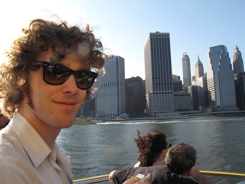 Matthew Hurst riding on a boat by Lower Manhattan, New York City