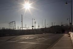 (Josphine Runneboom) Tags: california road railroad bridge sun train lights losangeles downtown glare crossing tracks x cables wires downtownla xing railroadtracks downtownlosangeles
