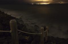 An Ocean Darkly (Yamaneko_) Tags: ocean city longexposure sea rock fog stone night stairs island lights bay spain darkness path rocky lanzarote rope distance ghostly canaryislands blindphotographers