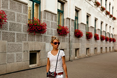 red sunglasses and flowers (flamed) Tags: travel flowers red portrait white bag vanishingpoint purse romania unionjack handbag timisoara
