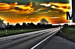 road to munich airport (FeMue) Tags: road sunset sky digital canon germany munich mnchen fire eos rebel lights airport sonnenuntergang air burning flughafen effect hdr strase 550d t2i