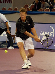 Wayne Ferreira hitting a backhand - by maartmeester