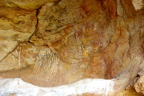 ancient rock art with William Wright's graffiti (in blue) over the top of it