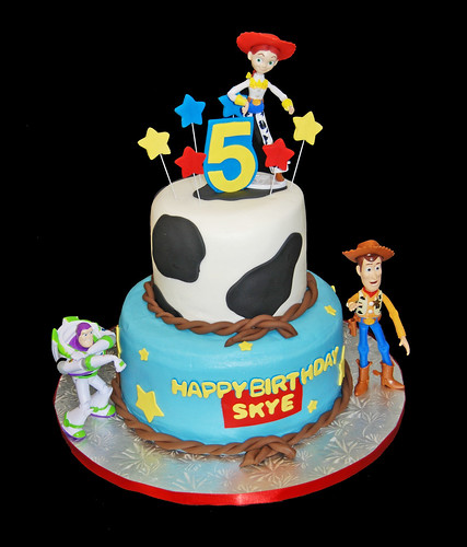 5th Birthday Cow print and stars 2 tiered cake with Toy Story figurines
