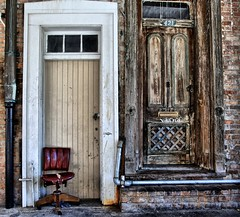 The Chair outside 421 (Ken Yuel Photography) Tags: chair louisiana urbandecay neworleans unitedstatesofamerica waterpipes frenchquarterneworleans urbangrunge digitalagent kenyuel oldofficechairs woodendoorsweatheredwoodendoors