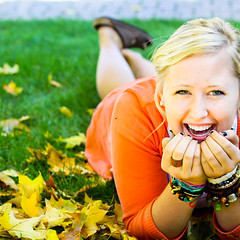 laughter is the simple cure to most of life's problems (Danielle Earl Photography) Tags: autumn fall girl smile grass leaves 50mm eyes warm laugh f18 101010