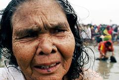 A old face. (subirbasak) Tags: poverty portrait people water face women ritual basak wrinkle pilgrim rites subir nikond60 peopleofindia subirbasak oldagepeople subirbasakorgfreecom traditionalritual olderface