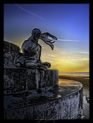 Blinded by the Setting Sun (Il.Falco) Tags: sunset sea sky sun beach water statue photoshop canon sand waves sundown belgium belgi powershot oostende sven bel hdr highdynamicrange ostend hdri topaz canonpowershot settingsun workflow sx20 vlaanderen ilfalco bauwens photomatix dfine colorefex cs5 niksoftware waterbreaker silverefex topazadjust ilfalcohdr