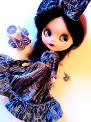 Little witch in grey velvet dress.