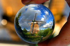 A Dutch windmill, Amsterdam  The Netherlands. Crystal ball (kees straver (will be back online soon friends)) Tags: street city flowers blue light shadow sky white plant flower holland color macro green mill water netherlands windmill dutch l