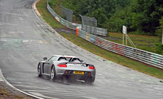 Porsche Carrera GT on a wet Nordschleife (Martijn Kapper) Tags: rain canon germany eos 26 hell july ring exotic rainy porsche british juli gt 06 groene hel carrera 2010 612 tf nordschleife nurburgring bhp nrburg nurburg touristenfahrten