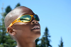 The Mountain in his mind's eye (1.0) (The Bacher Family) Tags: park 2 summer portrait orange reflection sunglasses topv111 canon published diversity naturallight mountrainier mountrainiernationalpark topv 500v facebook contestentry exhibited 1000v cotcpersonalfavorite tumblr publishedinprint thelightisall photovotr campingadventureswithmyparents lpstanding puyallupfair2011