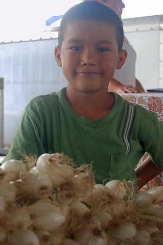the hard, little worker who sold me green onions
