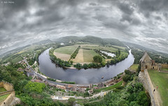 Dordogne River (Ben Heine) Tags: houses light wallpaper sky cliff mist france mountains art history tourism nature ecology fog clouds composition poster landscape photography high focus scenery village pov maisons altitude details horizon hill perspective arts culture atmosphere wideangle vert rivire ciel arbres cumulus terre fields walls prigord paysage past falaise chteau forests brouillard connection ecosystem middleage 180degrees planetearth cs4 mattepainting jeannedarc highquality littletown dordogneriver beynacetcazenac patrimoineculturel forts benheine greenflora flickrunited fisheyesimulation samsungnx10 infotheartisterycom streetcurves castleofbeynac luciengrosso printcopyright waterscapereflection benheinecom