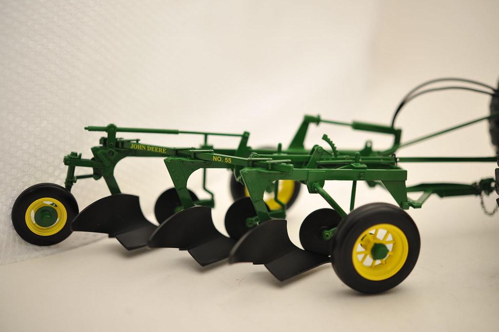 John  Deere  GM  Tractor  and  Model  55  plow  1/16th  diecast  metal  by  Ertl