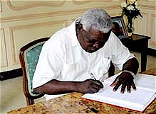 Cuban Vice-President Esteban Lazo Hernandez signing the book of condolences for the recently passed Rev. Lucius Walker of the United States who was a longtime friend of the Cuban Revolution. Walker led the IFCO agency and the Pastors for Peace. by Pan-African News Wire File Photos