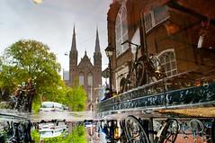reflections upside down  in Amsterdam (Andrew Greening) Tags: world street light holland colour art water rain amsterdam bicycle reflections licht upsidedown pentax nederland divine plas regen stad fiets straat pentaxk20