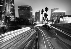The 110 at Night (Black and White) (twentyonecuts) Tags: california city longexposure urban blackandwhite bw white black cars night clouds canon outside outdoors blackwhite losangeles los highway long exposure downtown traffic angeles 110 overcast freeway i110 50d flickraward flickraward5 ringexcellence dblringexcellence