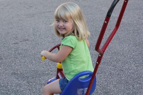 Catie on her tricycle