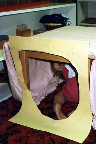 Christina (2 1/2) crawling through the KONOS-style model ear she and Will made in our Montessori classroom, 1992.