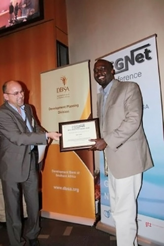 Andrew Mude of ILRI receives IBLI award