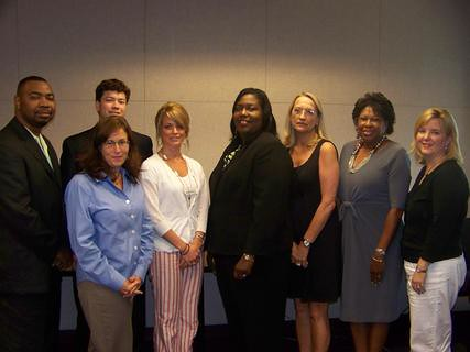 Mississippi Rural Development State Director Trina N. George (center) stands with Congressional staff members who participated in a recent briefing on Rural Development 2010 programs.