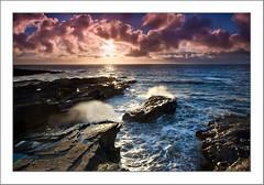 Evening drama (Sean Reidy Photography) Tags: ireland sea sky seascape rock clouds landscape coast clare waves naturallight backlit backlighting irishlight dragondaggerphoto