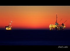 black water (Eric 5D Mark III) Tags: california longexposure light sunset orange twilight mood offshore platform atmosphere telephoto tele orangecounty huntingtonbeach tone oilrig drilling petroleum ef70200mmf28lisusm extenderef2xii