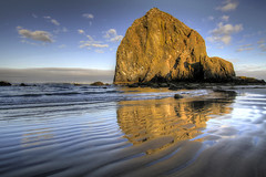 Reflection of Haystack Rock at Cannon Beach 2 - HDR (David Gn Photography) Tags: sea seascape reflection water clouds sunrise landscape waves sandy scenic bluesky pacificocean pacificnorthwest oregoncoast ripples cannonbeach haystackrock hdr morningsun 3xp canoneos7d sigma1020mmf35exdchsm sigma50th