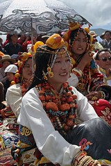 5710564327506962154 (BetterWorld2010) Tags: tibetans coral festival gold amber necklace beads costume treasure dress jewelry tibet ring celebration bracelet amdo kham sichuan traditionalcostume 2009 litang headdress robes yushu  tibetanwoman    khampa golok lithang tibetangirl tribalcostume tibetanfestival  tibetanwomen