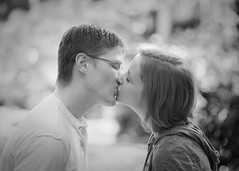 Precious Little Moment (Chase Hoffman) Tags: portrait people blackandwhite woman white man black girl monochrome canon person eos glasses blackwhite engagement kiss kissing colorado dof greg bokeh denver depthoffield telephoto annie client downtowndenver engagementsession clientwork canonef70200mmf4lusm chasehoffman canoneos5dmarkii 5dmarkii 5dmkii chasehoffmanphotography