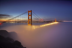 Fog at the Golden Gate #1 - San Francisco (PatrickSmithPhotography) Tags: sanfrancisco california bridge red sky usa cloud seascape art rock fog skyline sunrise buildings landscape downtown unitedstates fineart goldengate baybridge marincounty