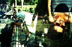 (OuroborosX) Tags: sunglasses silhouette lomo lca xpro lomography crossprocessed washingtonsquarepark chess megan multipleexposure tripleexposure
