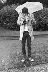 man with umbrella and camera (gorbot.) Tags: blackandwhite bw me umbrella hasselblad canoneos5d nikonfmount planar5014zf takenbyroberta airthcastlehotel carlzeisszf50mmplanarf14 eosadaptor shitscottishweather