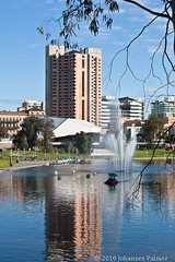The Hotel Intercontinental by the Torrens River (Johannes Palmer) Tags: urban building water grass architecture reflections river citylife sunny australia bluesky structure spray highrise adelaide riverbank paddleboat torrens lawns foutain festivaltheater