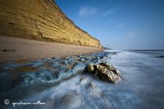 HIve Beach low tide 4 (grahamwiffen) Tags: longexposure seascape beach water bay coast movement nikon rocks waves cliffs limestone lowtide ledges burtonbradstock jurassiccoast d90 sigma1020 hivebeach nd110
