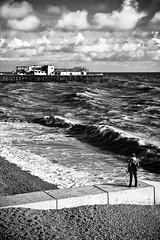 Hastings pier 30.10.10 (baxcarias) Tags: sea bw white black canon fire pier photographer hastings groyne burned seascpae