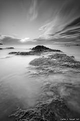 Rocas y mar (Carlos J. Teruel) Tags: espaa sol sunrise mar nikon paisaje explore murcia amanecer nubes cabodepalos 2010 d300 tokina1116 xaviersam