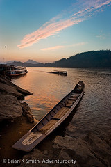 Mekong Boats at Sunset, Luang Prabang (adventurocity) Tags: travel sunset vacation tourism photography boat photo asia southeastasia photographer picture visit tourist traveller adventure laos visitor mekong luangprabang traveler indochina luangphrabang