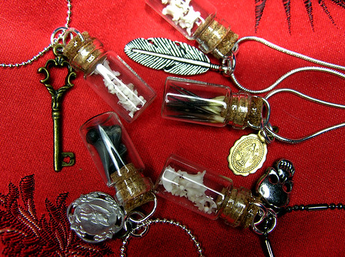 Small Glass Vial Pendants with Various Charms: Snake Vertebrae, Porcupine Quills & Shark Teeth